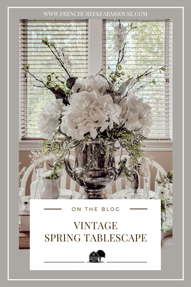 Our spring home tour continues with a vintage inspired tablescape