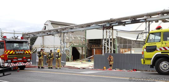 """Fire Service and police speak to media soon after attending a sulphur fire at Ravensdown fertiliser plant at Awatoto, near Napier. SH2 was closed from Waitangi Rd to Farndon Rd for what was expected to be """"a long time."""" photograph"""