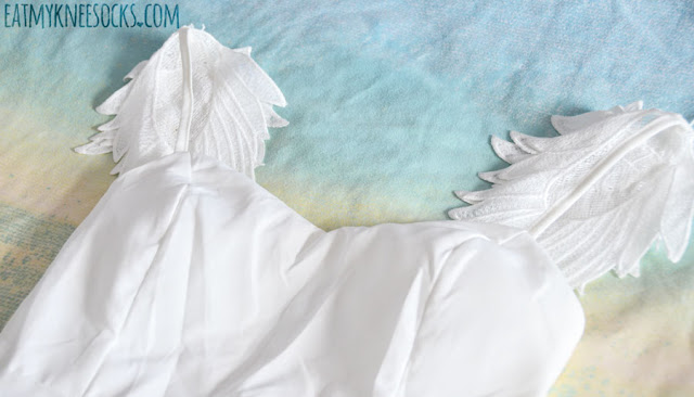 Details on the all-white angel wing embroidered flared skater dress from Romwe.