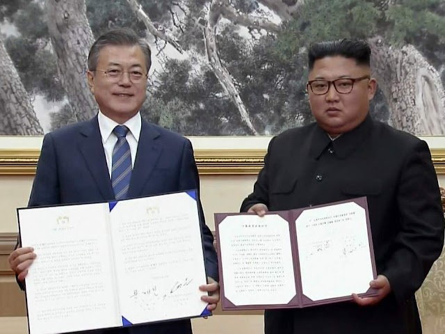North and South Korean leaders sign joint agreement on denuclearisation in 'leap forward' for peace