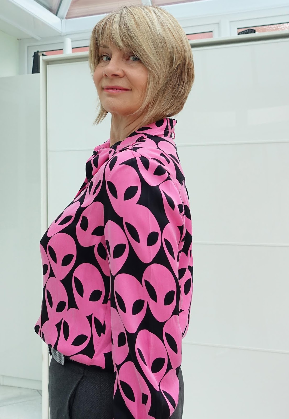 There's a ttwist in the design of this Fabienne Chapot blouse - it features aliens. Worn with grey and silver by Is This Mutton style blogger Gail Hanlon