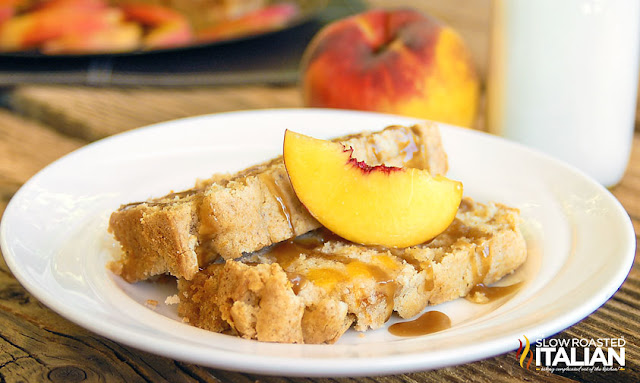 slice of peach pound cake on a plate with caramel sauce