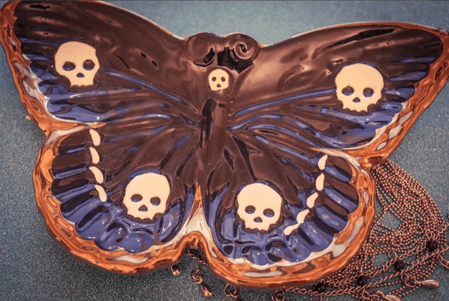 Moth shaped black plate