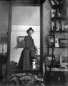 A woman taking a picture in front of a mirror