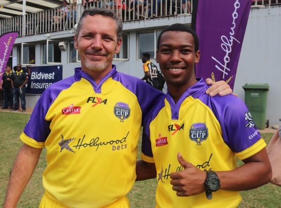 Rugby Referees pose in their purple and yellow Hollywoodbets Kit