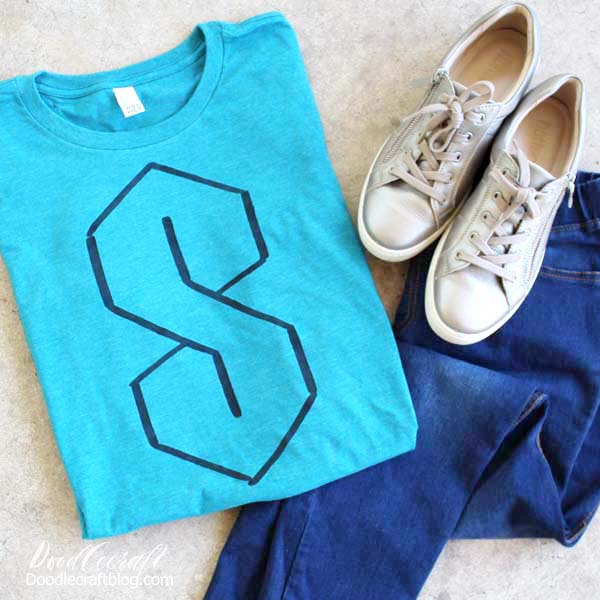 "1990's ""S"" Shirt in turquoise painted with black fabric paint using Freezer paper as a stencil. Simple, quick and nostalgic DIY!"