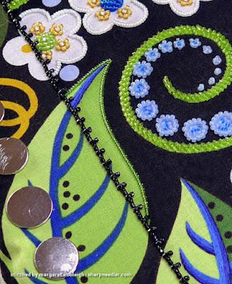 Results of using a beading koma: a smooth lline of couched beads