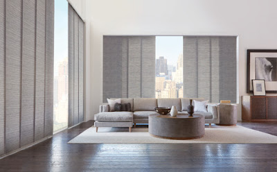 Cover sliding glass doors or wide windows with Hunter Douglas Skline Gliding Window Panels, a trendy vertical choice!
