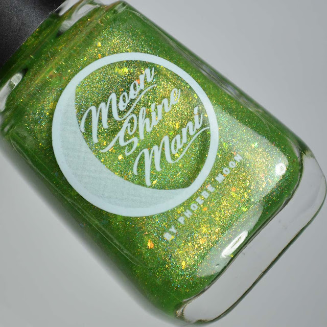 green holographic nail polish in a bottle