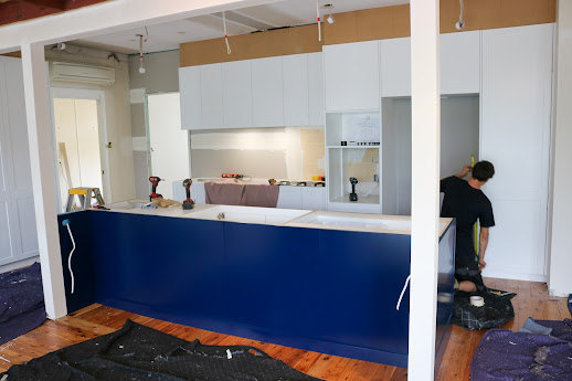 Kitchen cabinetry goes in