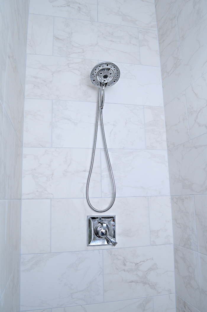 12x24 Marble Look Tiles and Marble Hex Tile Floor in a Master Shower Stall with Chrome Fixtures   via monicawantsit.com