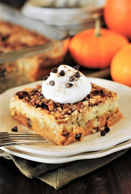 Chocolate Chip Pumpkin Dump Cake with Whipped Cream Image