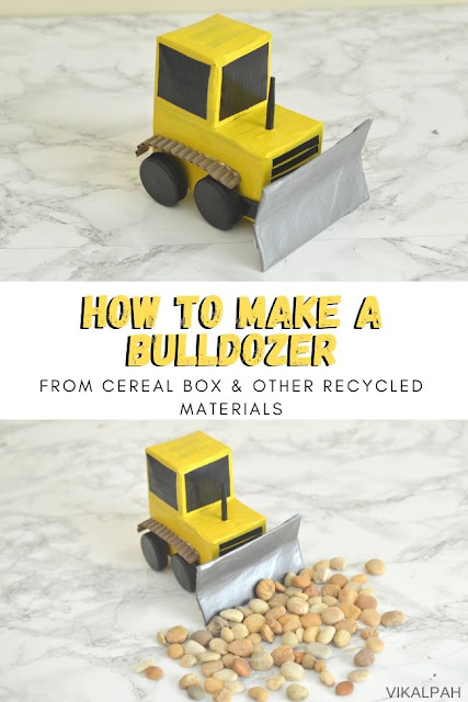 Bulldozer toy made using cereal box and other recycled materials displayed