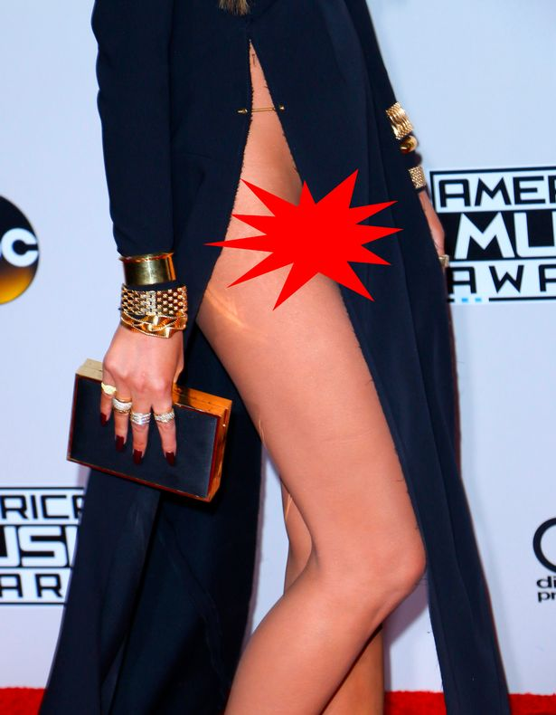 John-Legend-and-Chrissy-Teigen-arrive-for-the-2016-American-Music-Awards-red-carpet-at-the-Microsof