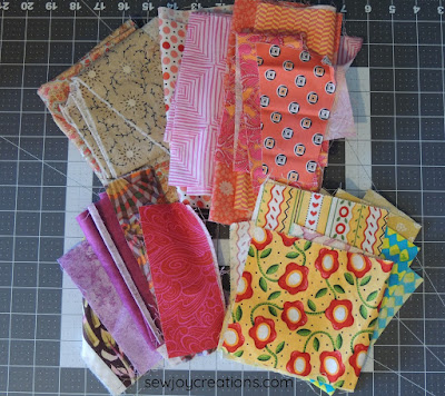 warm colour fabrics liberated churn dash quilt