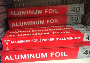 Many boxes of Dollar Tree Unbranded Aluminum Foil sitting on a shelf, ready to ruin your day