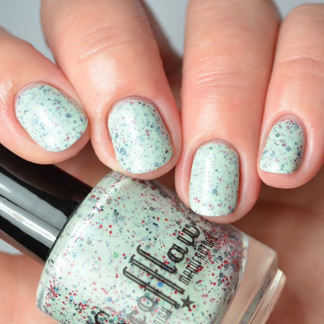 mint nail polish with red and black glitter four finger swatch