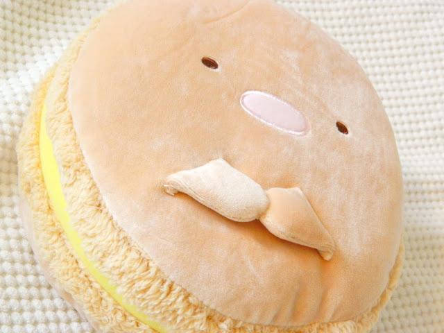 A photo showing a Summikko Gurashi character macaron cushion