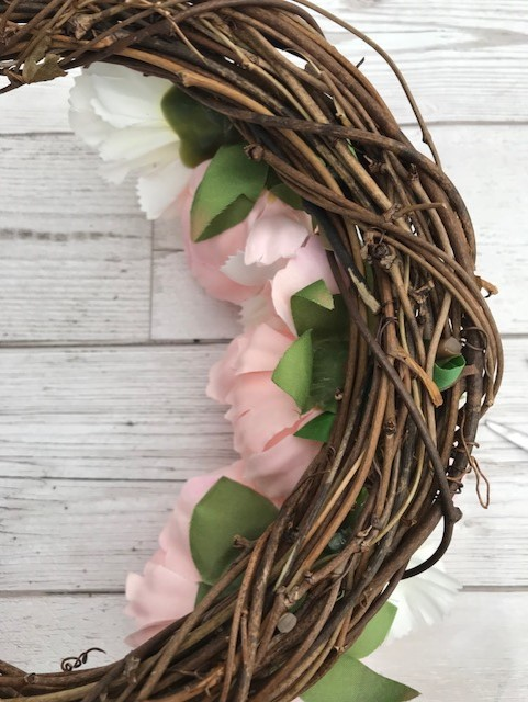 The back of the wreath with the stems cut shorter