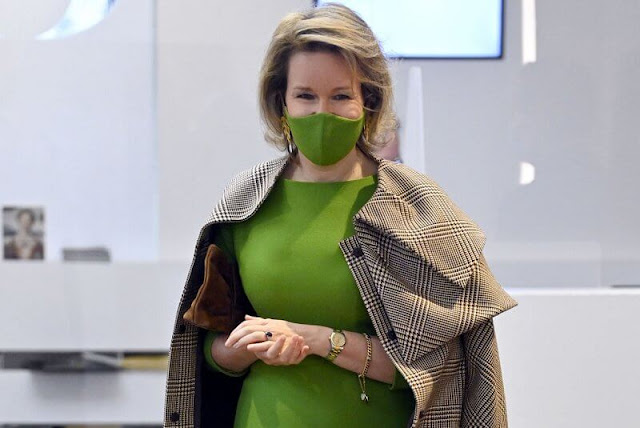 Queen Mathilde wore a checked wool coat from Natan, and green wool dress from Natan