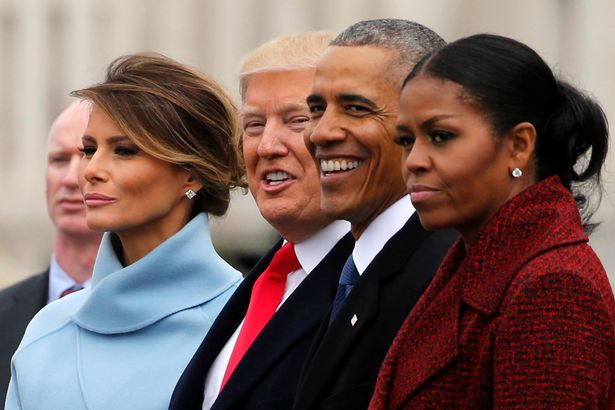 Trump-and-his-wife-see-off-the-Obamas-as-they-depart-following-Trumps-inauguration-at-the-Capitol-i