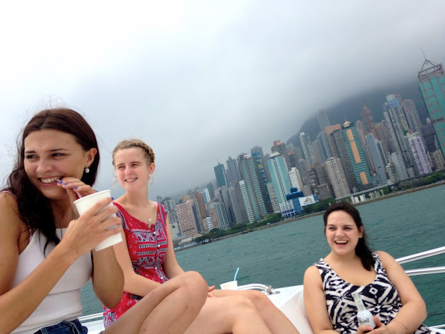 Girls on a junk boat in Victoria Harbour, Hong Kong