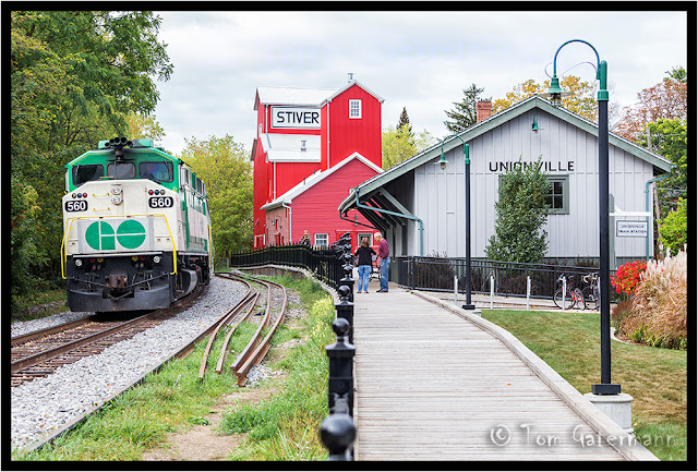 GO Transit 560 passes Stiver Mill at the old Unionville depot, in Markham, ON.
