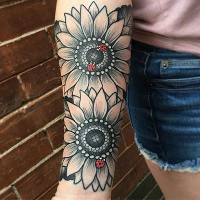 ladybug on sunflower tattoo