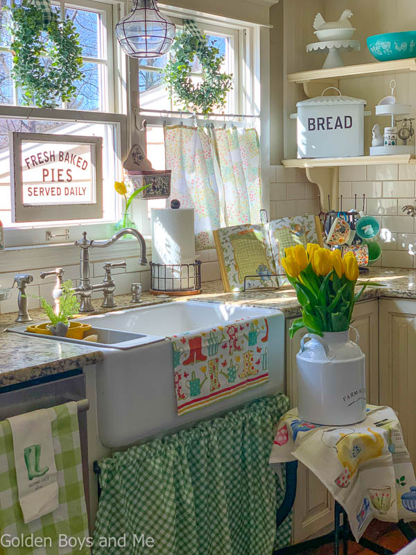 Farmhouse sink in cottage style kitchen with spring decor - www.goldenboysandme.com