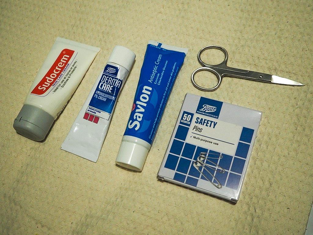 Sudocrem, itch cream, savlon, safety pins, nail scissors