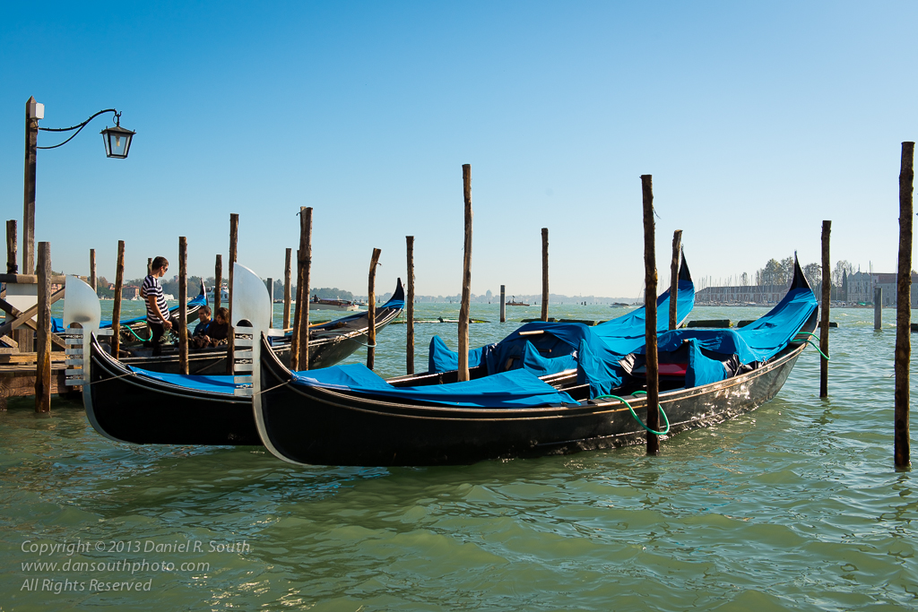 a photograph of gondolas in venice italy by daniel south