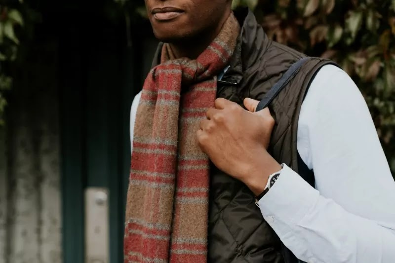 A male carrying blanket scarf with knot style.