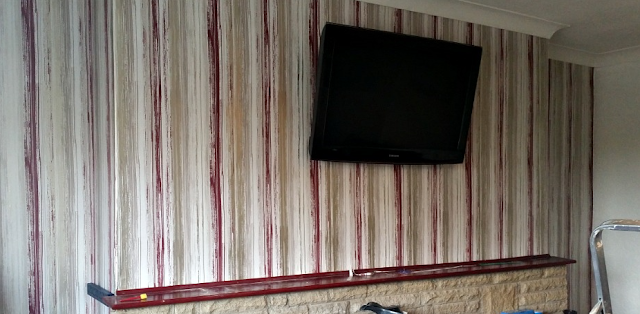 Our new wallpaper up. Red and silver stripes