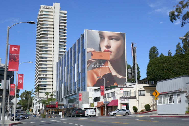 Giant Hermès Beauty Orange turns red billboard