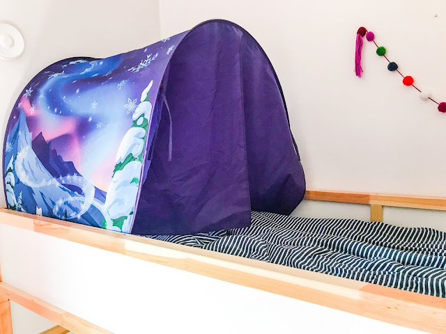 A view of the Wonderland Dream Tent on a bed with the doors closed providing privacy and no view of inside