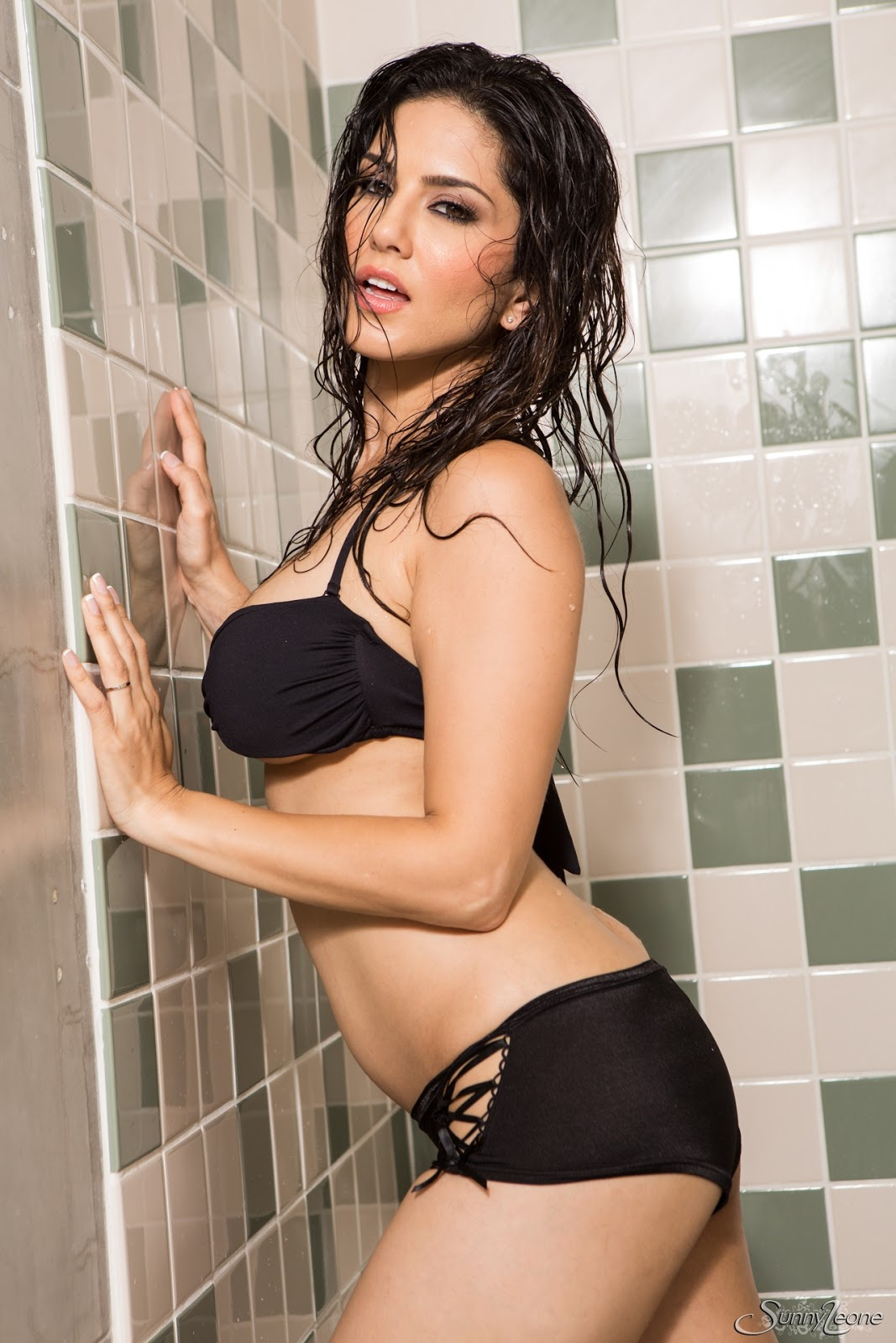 Sunny Leone is taking a hot shower while in her Black wet ...