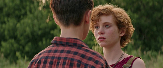 Image from IT based on the book by Stephen King, starring Bill Skarsgard as Pennywise, Sophia Lillis as Beverly, Jaeden Lieberher as Bill, Finn Wolfhard,
