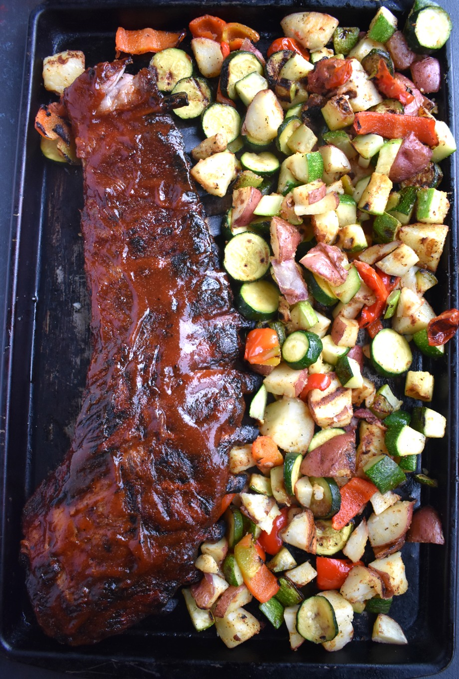 rack of ribs and grilled vegetables