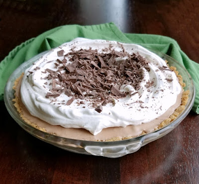frozen pie with whipped cream and candy on top ready to serve