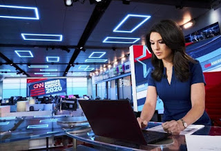 Ana Cabrera working in the office