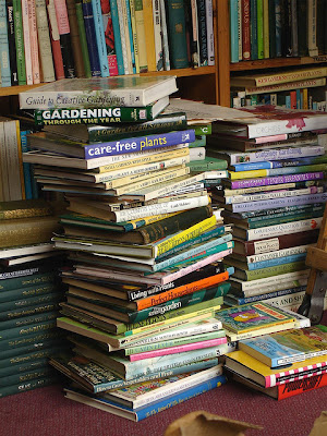 stacks of gardening books