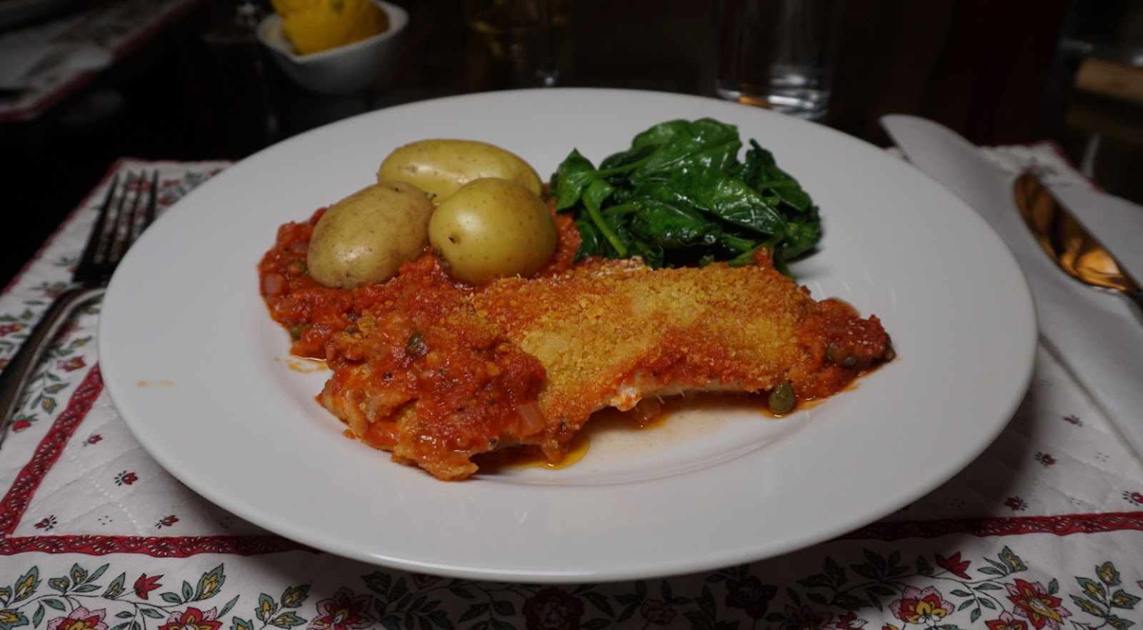 Baked white fish in tomato sauce and capers