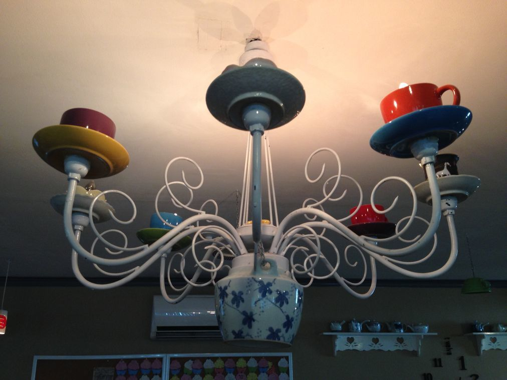 Lights made of tea cups and pots at Tea Tree Café