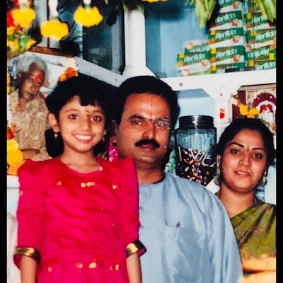Haripriya's childhood picture with her father and mother