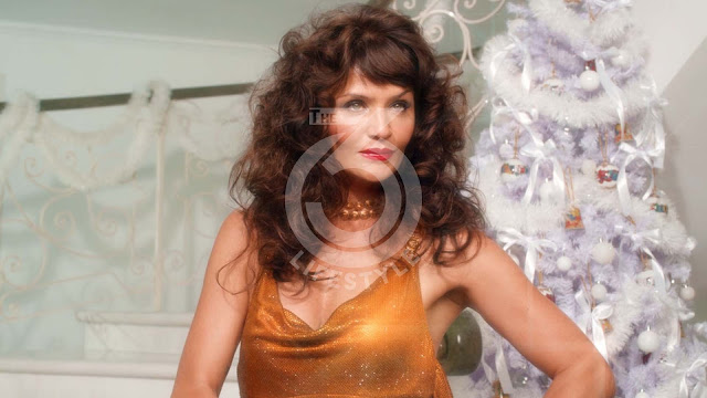 Helena Christensen, utterly kitschy heroine of Versace's end-of-year campaign