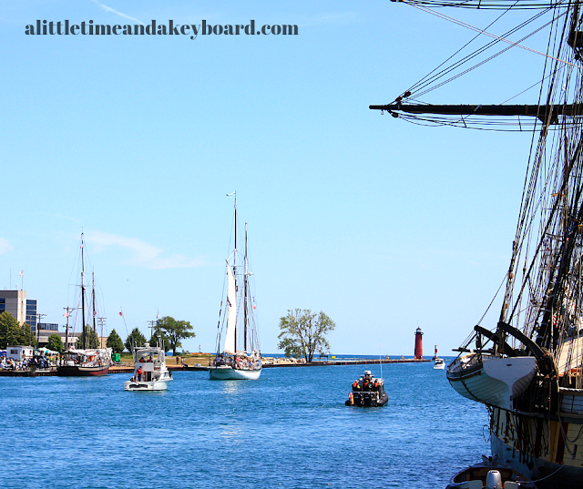 Tall ships and other vessels enjoying a spectacular day in Kenosha's harbor