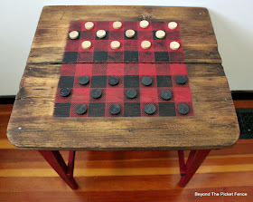 make a checkerboard table for perfect rustic cabin decor
