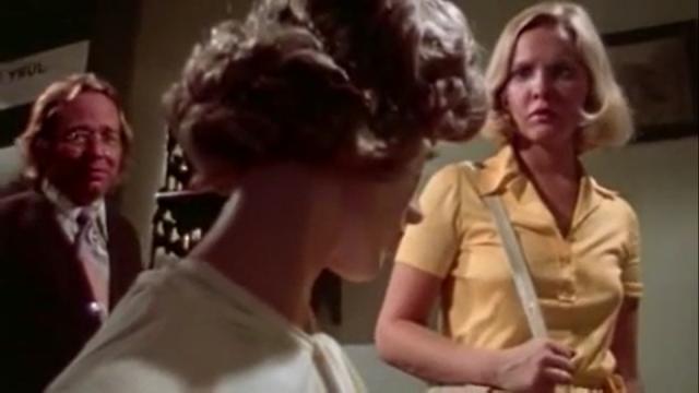 Claude (Larry O'Dwyer) shows Amanda (Susan Bracken) the mannequin he has dressed to look like her murdered mother in DON'T OPEN THE DOOR.