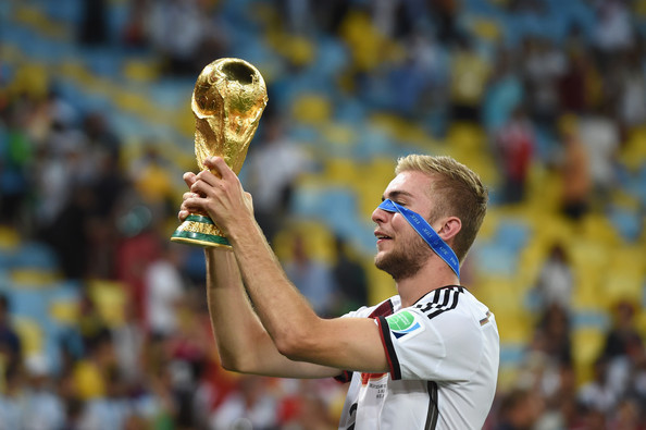 Christoph Kramer of Germany celebrates with the World Cup trophy after defeating Argentina 1-0 in extra time during the 2014 FIFA World Cup Brazil Final match between Germany and Argentina at Maracana on July 13, 2014 in Rio de Janeiro, Brazil