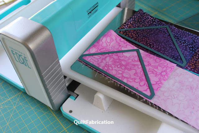 cutting a triangle from a pink strip